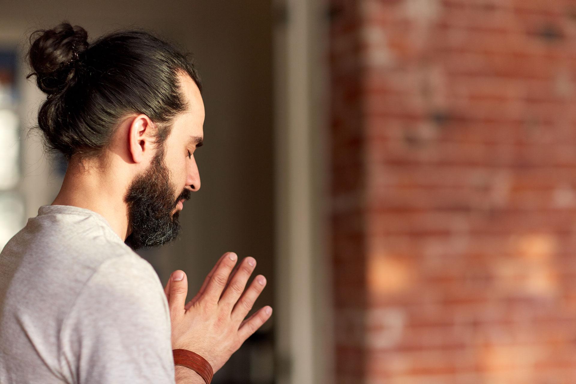 close-up-of-man-meditating-at-yoga-studio-PHBLPPB