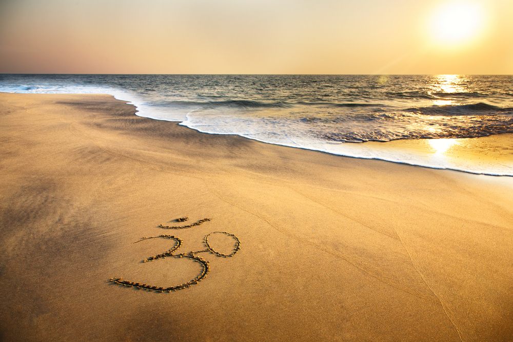 Om,Symbol,On,The,Sand,At,The,Beach,Near,The
